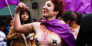 Lucía, a 21-year-old lesbian from France, bares her breasts and torso as a way of expressing her right to decide. (Photo: Mayela Sanchez)