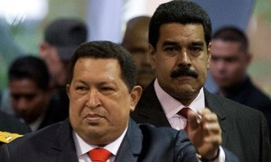 Hugo Chávez, left, and Nicolás Maduro, Chavez's hand-picked successor, in Caracas last year. Photograph: AP