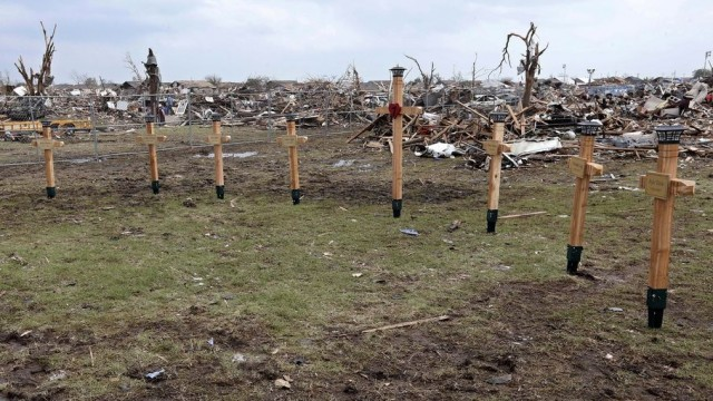 Crosses erected by the workers of the Moore Public Schools maintenance department are pictured at the Plaza Towers elementary school, in Moore, Okla., Friday, May 24, 2013. They were built in memory of the seven children who died during the Moore tornado. (AP Photo/Sue Ogrocki)