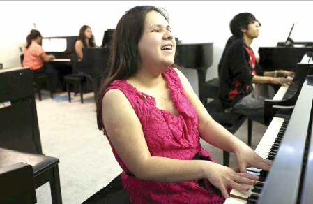 Betina Vega plays on a piano. The 20 year old is the first and only person in San Antonio to teach piano braille music. She is looking for a master of braille music to hone her skills.