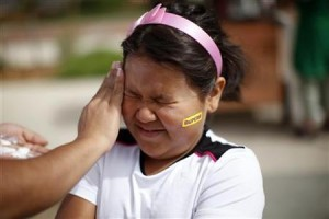 Fernanda Garcia-Villanueva, 8, has sunscreen applied before the annual run/walk for patients and their friends and families at The Children's Hospital in Aurora