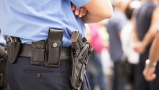 A recent court decision against stop and frisk speaks specifically to racial profiling, but we know that other kinds of profiling—based on gender, sexual orientation, economic status, and other characteristics—are often used by police. (Police officer via Shutterstock)