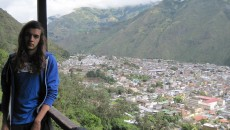 With Santa de Baños de Agua Santa, Tunguruhua, Ecuador as a backdrop, August poses for his last picture before disappearing hours later.