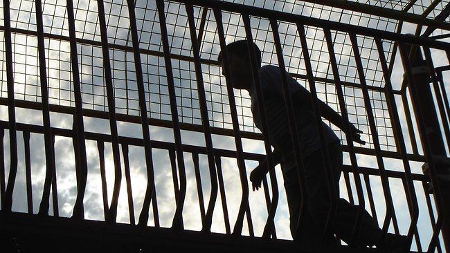 523419-kid-silhouette-in-prison
