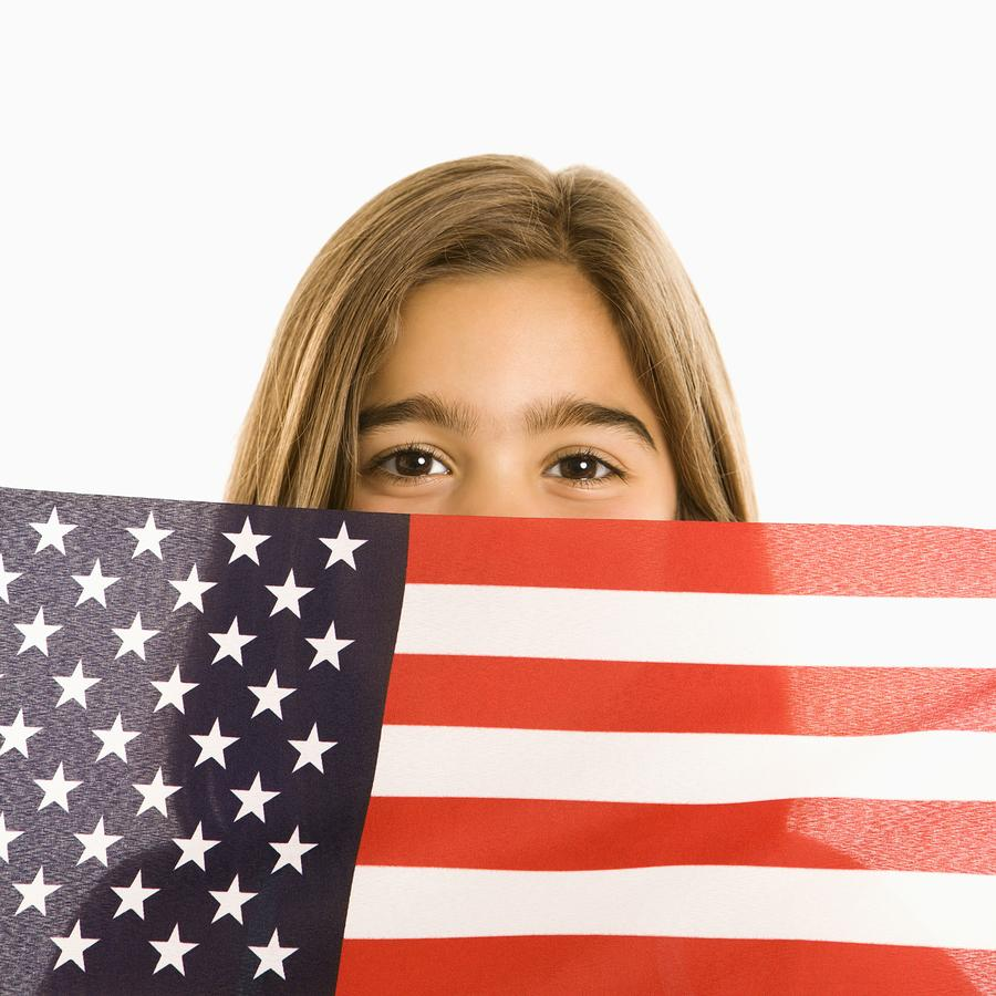 bigstock-girl-holding-american-flag--2682786
