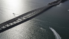 """Water Under the Bridge"" features the Rickenbacker Causeway, which connects Miami to the barrier islands of Virginia Key and Key Biscayne across Biscayne Bay."