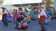 Young members of the community participate in a traditional dance at the Annual Lincoln Park Day.