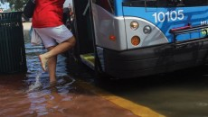 gw-impacts-sea-level-rise-tidal-flooding-miami-florida-woman-boarding-bus
