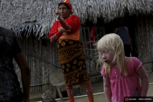 "Iveily Morales, 3, who is part of the albino or ""Children of the Moon"" group in the Guna Yala indigenous community, stands next to her mother at their house on Ustupu Island in the Guna Yala region, Panama April 24, 2015. REUTERS/Carlos Jasso"