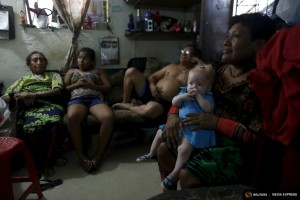 "Eight-month-old Aisha Guerrero, who is part of the albino or ""Children of the Moon"" group in the Guna Yala indigenous community, sits on her Aunt's lap in Panama City, Panama May 9, 2015. REUTERS/Carlos Jasso  SEARCH ""JASSO MOON"" FOR ALL IMAGES"