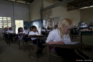 "Yaisseth Morales, 11, who is part of the albino or ""Children of the Moon"" group in the Guna Yala indigenous community, is seen in her classroom at the local school on Ustupu Island in the Guna Yala region, Panama April 27, 2015. REUTERS/Carlos Jasso"