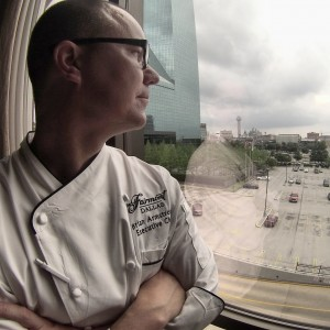 Chef Brian of the Pyramid restaurant in Dallas' Fairmont Hotel surveys the skyline on his way to his rooftop garden.