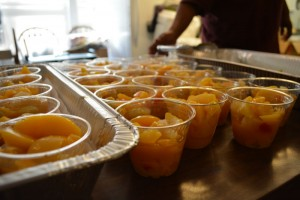 Fruit cups are set out for guests at the Southside Community Shelter. Photo by Jesse Louden/VoiceBox Medias