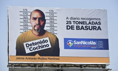 View of a billboard with a picture of a person arrested for littering in Monterrey, on July 29, 2015. People who are fined for littering in prohibited sites in San Nicolas de los Garza, Monterrey's metropolitan area, will also be featured in street advertisements, authorities reported.   AFP PHOTO/RONALDO SCHEMIDT