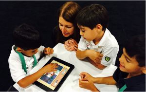 Bilingual Children's Enterprise founder Deborah Castillero tests her new app with homeschooled children at a May conference in Miami. (Photo courtesy Deborah Castillero)