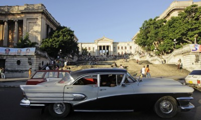 "A privately owned taxi is driven past Havana's university September 13, 2010. Cuba will let more than 500,000 state employees go by next March and try to move most to non-state jobs in the biggest shift to the private sector since the 1960s, the official Cuban labor federation said on Monday. According to Communist party sources who have seen the detailed plan to ""reorganize the labor force,"" Cuba expects to issue 250,000 new licenses for self-employment by the close of 2011, almost twice the current number, and create 200,000 other non-state jobs. REUTERS/Desmond Boylan (CUBA - Tags: SOCIETY TRANSPORT EMPLOYMENT BUSINESS POLITICS) - RTR2IAS5"