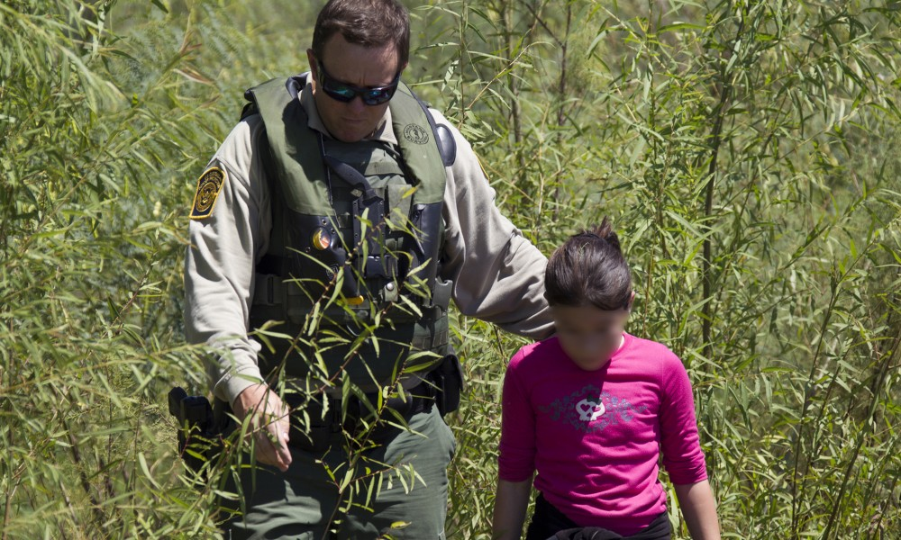 A Border Patrol Riverine Unit conducts patrols in an Air and Marine Safe-Boat in South Texas along the Rio Grande river.  They rescue a child who is stranded on the river bank of the Rio Grande. Photographer: Donna Burton